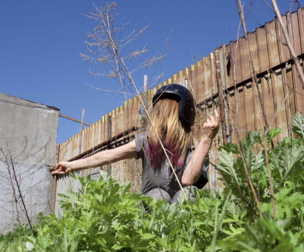 woman performing dance in garden