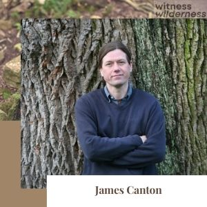 man standing against an oak tree