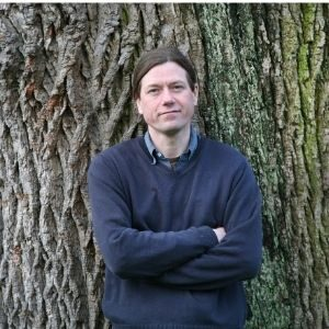 James Canton standing against an oak tree.